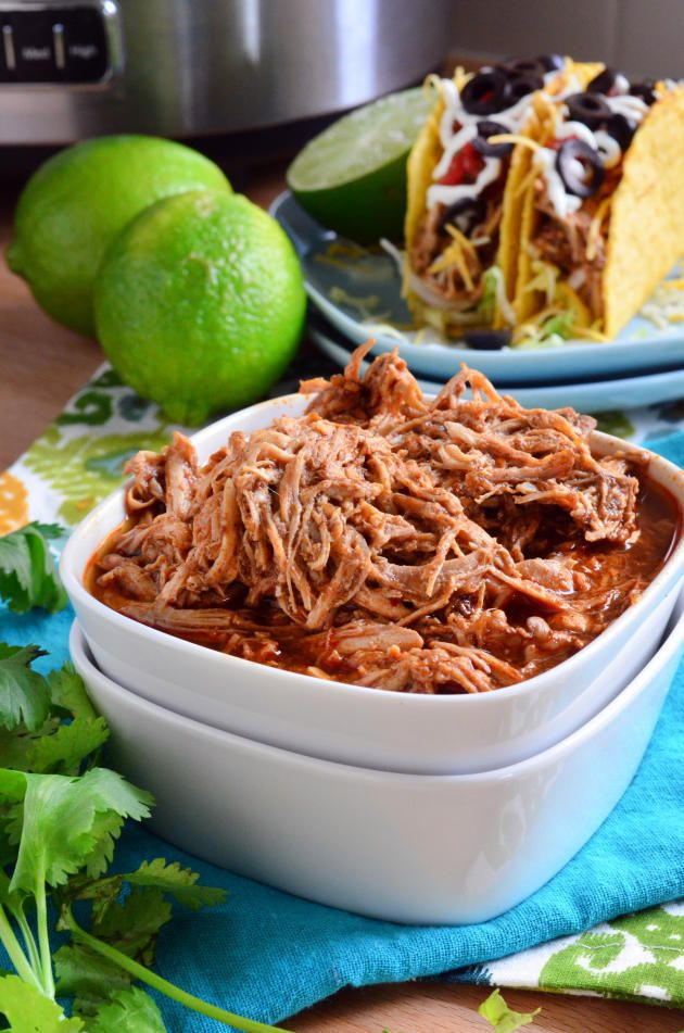 Slow Cooker Shredded Chicken Tacos make a delicious supper. Make a taco bar with toppings for extra fun.