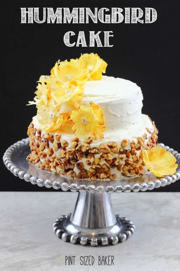 Simple and beautiful! This Hummingbird cake with pineapple buttercream is so elegant with the pineapple flowers.