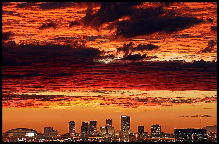 Phoenix skyline at sunset as seen from 9 miles east.  City Statistics. www.mdhomehealth.com #phoenix #arizona