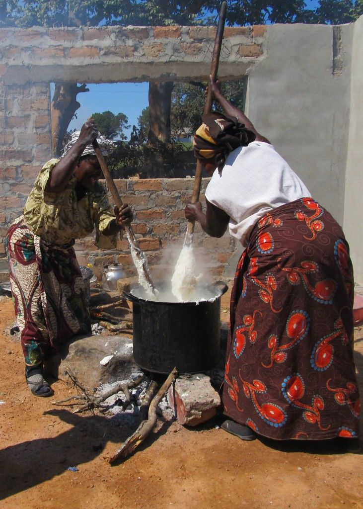 Women in Zambia stirring a traditional pot of Nshima #recipe #Olympic Feasts