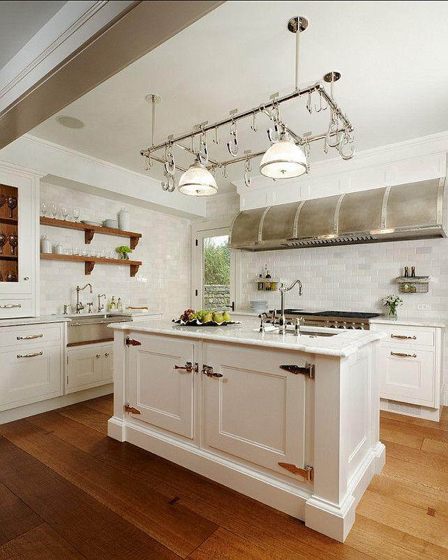 Kitchen. White Kitchen with pot rack. Pot Rack is from Ann-Morris Inc. #Kitchen #PotRack #KitchenDesgn