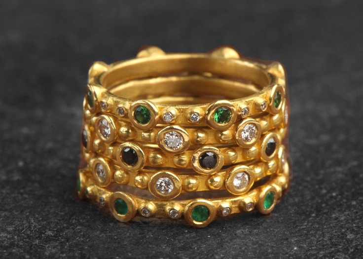 Stackable 22k gold rings with emeralds, black & white diamonds by Osnat Weingarten