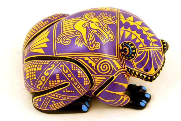 lLuis Pablo is considered one of the top Oaxacan wood carving masters. He is known for his realistic carvings and contemporary use of color and painting techniques.     This time he created a wonderful sapo, frog, and decorated it with Aztec, Pre Columbian motifs.
