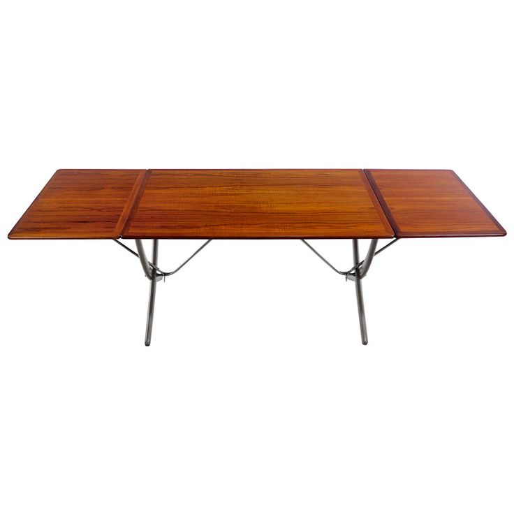 Exceptional Danish Modern Teak and Oak Drop-Leaf Dining Table by Hans Wegner | From a unique collection of antique and modern dining room tables at https://www.1stdibs.com/furniture/tables/dining-room-tables/