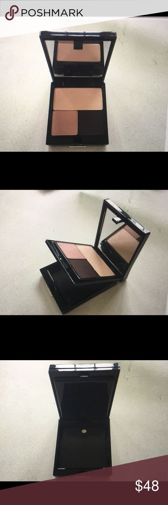 Trish McEvoy Double Decker Eye Shadow Pallet Brand new never been used. Only one left is a double decker Refillable Compact. This Compact includes 3 different Trish McEvoy Eye Shadows. The bottom is empty and can be filled with Trish McEvoy Bronzer, cheek color and more. This is part of Trish McEvoy magnetic color system. The 3 eye shadows are Deluxe Soft Peach 22.50, Glaze Rose Quartz 18.50 & Definer Deep Aubergine 18.59 plus the Compact. The total is $118.00 Trish McEvoy Makeup Eyeshadow