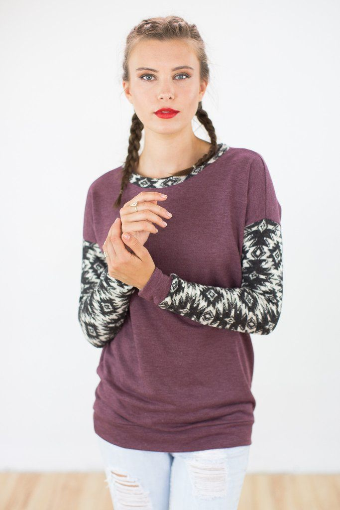 Sweater Tabinski in Purple.Casual and cosy sweater in purple. The sleeves and neckline are made of gray and white aztec patterned knit fabric. Easy to combine with a pair of skinny jeans, it can be worn every hour of the day.