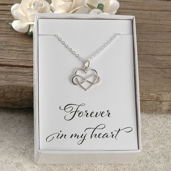 A sterling silver heart shaped infinity necklace. This comes in a gift box with a card that reads Forever in my heart. The charm measures 18mm