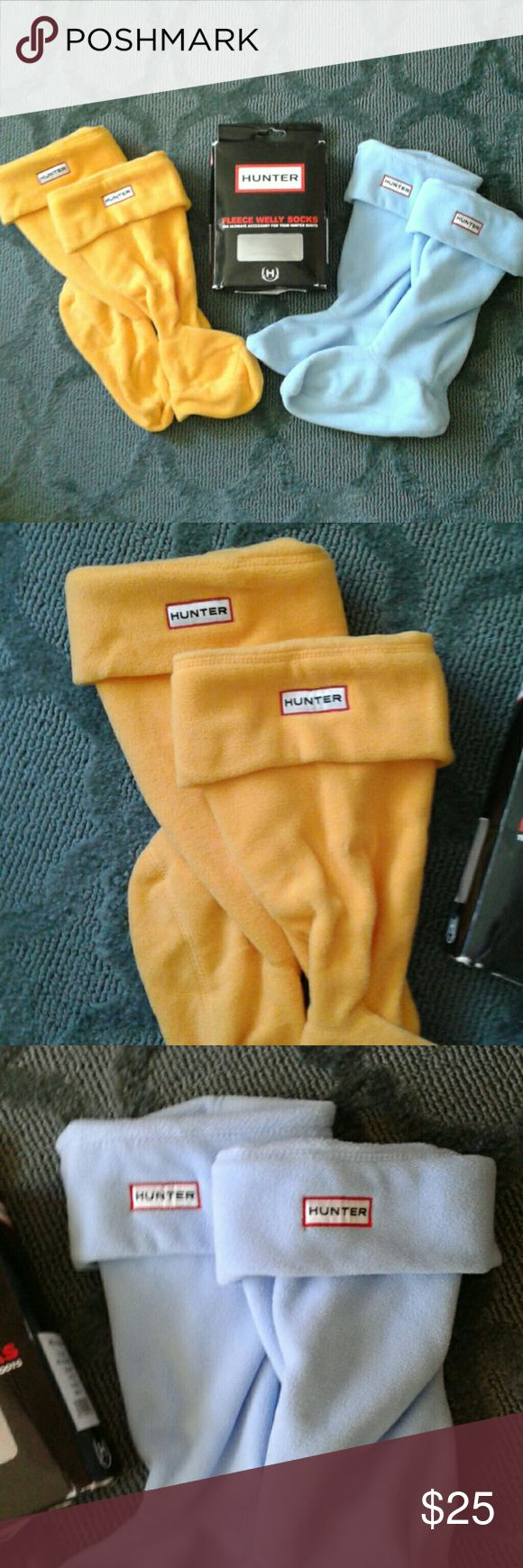 💕SALE💕 Hunter Fleece Welly Socks - Two Pair! I have two pair of Hunter fleece boot socks. These have never been worn.  They are a size Medium for tall boots. One pair is baby blue, while the other pair is a bright yellow. Hunter Boots Accessories Hosiery & Socks