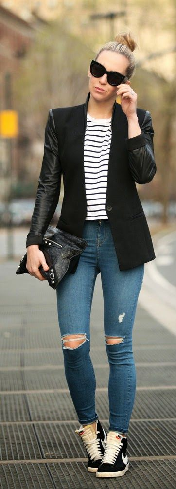For an edgier take on a classic black jacket, opt for one with leather detailing. High top sneakers complete this modern street style look!