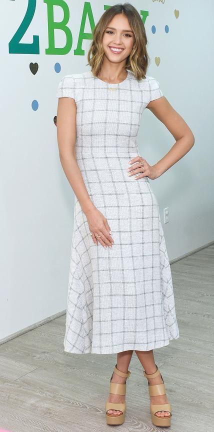 Jessica Alba wearing a windowpane Wes Gordon tweed dress, with strappy nude platforms.