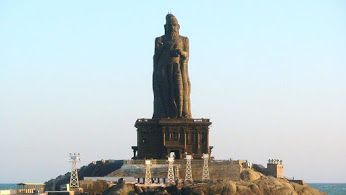 Thiruvalluvar Statue in Kanyakumari  The Thiruvalluvar Statue is a 133 feet (40.6 m, denoting the 133 chapters in the Thirukkural) tall stone sculpture of the Tamil poet and philosopher Tiruvalluvar, author of the 'Thirukkural'. It is located atop a small island near the town of Kanyakumari on the southernmost Coromandel Coast, where two seas and an ocean meet; the Bay of Bengal, the Arabian Sea, and the Indian Ocean .
