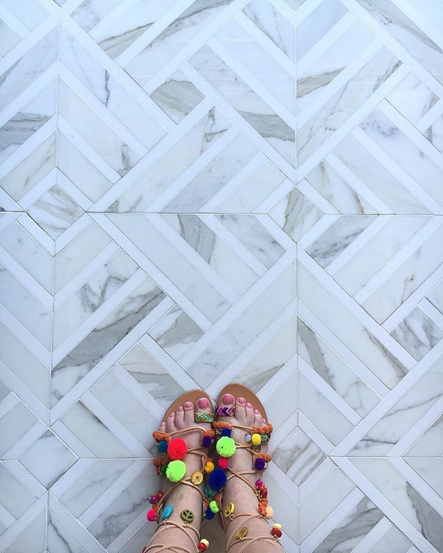 1. Large format mosaic patterns incorporated into rooms with a large floor plan…