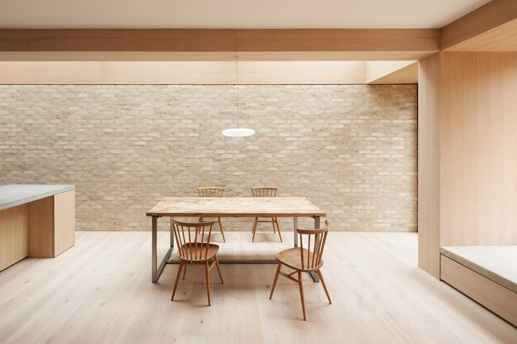 The architects removed the existing rear and side walls to insert the limewashed brick volume, which spans the full width of this three-storey house.