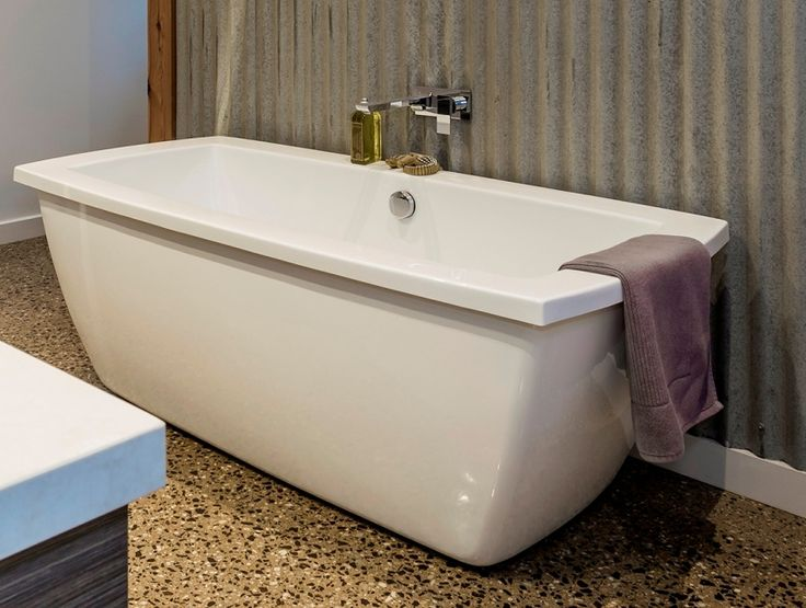 Utilising the backdrop of corrugated iron and a freestanding bath the sharp sleek lines of the Dorf Jovian Bath mixer tapware has been used.