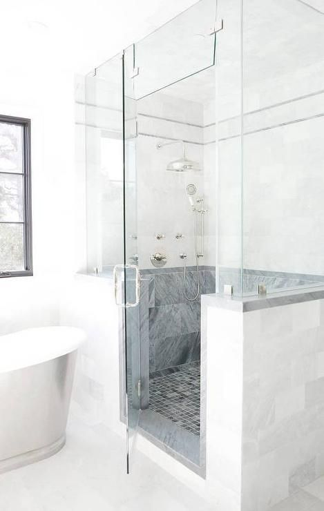 Sharon Taftian Interior Design - Stunning walk-in steam shower is enclosed behind a glass and marble enclosure and featuring blue Bardiglio marble grid floor tiles framed by Bardiglio marble backsplash tiles contrasted with white marble upper wall tiles holding a vintage hand held shower head beside a vintage rain shower head.