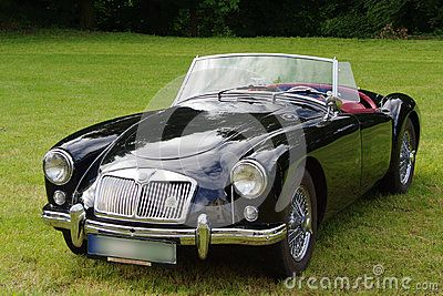 Antique, convertible MG sports car with the top down.