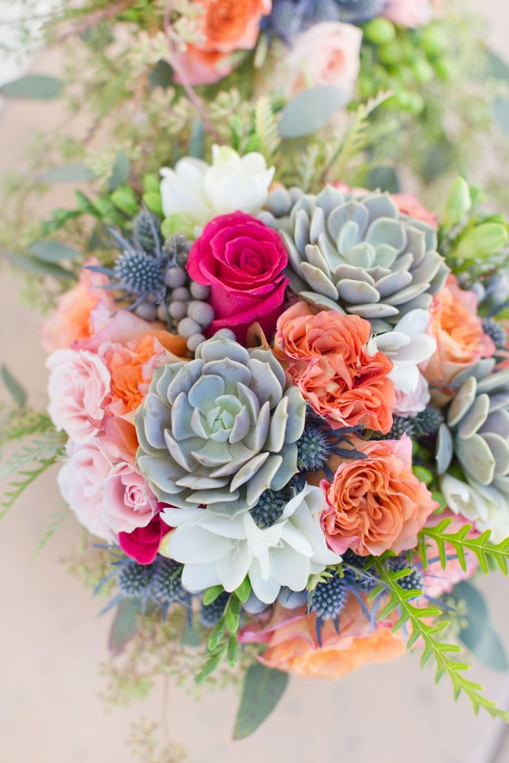 Colorful fall wedding at the Omni Montelucia Resort, in Scottsdale, Arizona. The bridesmaids wore pastel lavender, and the bouquets were soft purples, pinks, fuchsia and splashes of sea green. And the entire event was decorated throughout with succulents. They even used miniature cacti as the place holders for the reception.