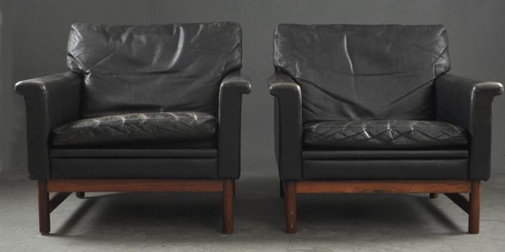 Leather and rosewood danish armchairs