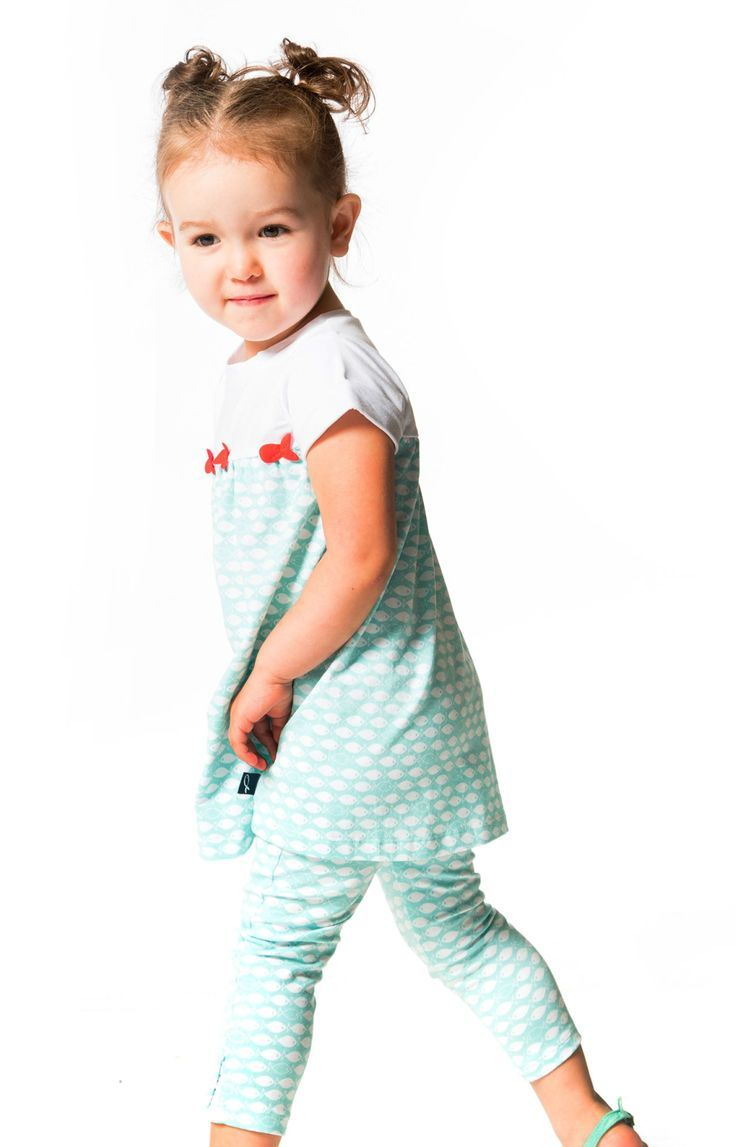 In a two-piece silhouette with an allover fish print, the High Style At Low Tide Tunic & Legging Set is simply perfect for any day on the coast or near the water. Made from cotton/spandex jersey, this set includes a short sleeve tunic top with cuffed sleeves, an allover print, contrast white trim, and colorful fish appliques at the front yoke.  Shop now at deuxpardeux.com #kidsstyle #dress #littlegirl #kidsfashion #littleboy #kidswear Follow our Pinterest page at @deuxpardeuxKIDS