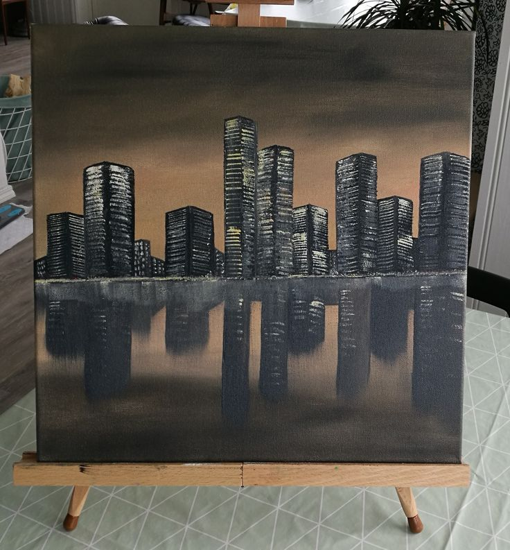 A dark city skyline with reflection in the water. Painted with water soluble oil paint.