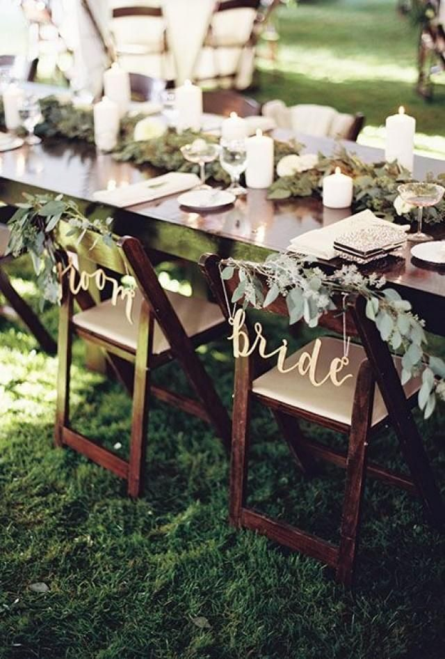 Weddbook ♥ Chairs decorated with eucalyptus and wildflower garlands and signs of bride and groom from bhldn will look superb at your wedding. This personalized pair of chairs will be perfect to make bride-groom special on their wedding day