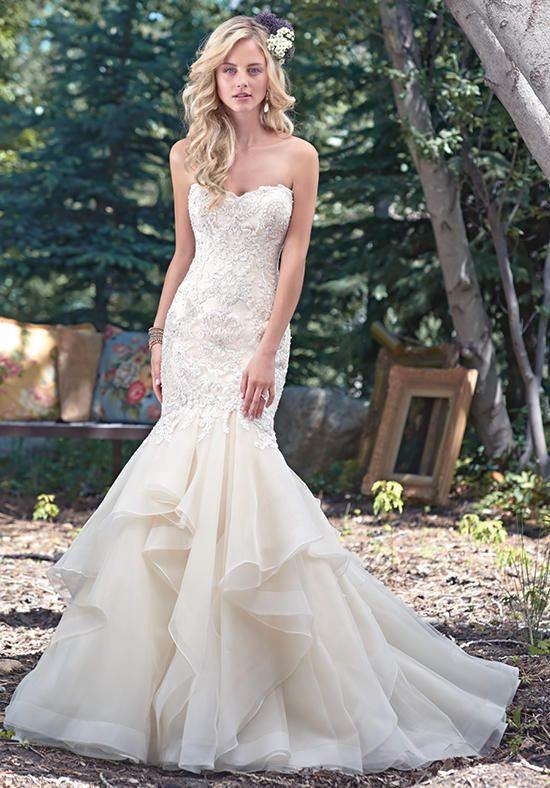 Fitted lace mermaid dress, accented with Swarovski crystals, and voluminous tiers of tulle and Chic organza layered throughout the skirt | Maggie Sottero | https://www.theknot.com/fashion/malina-maggie-sottero-wedding-dress