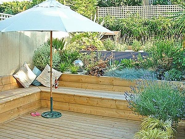 Bench built into raised bed garden pinterest for Decking terrace garden