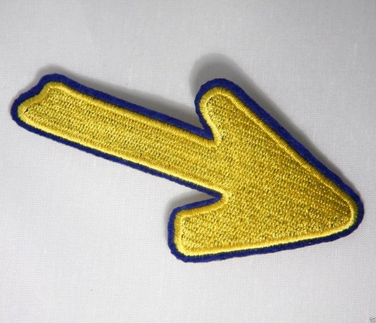(http://www.spanishdoor.com/camino-de-santiago-pilgrim-cloth-patch-st-james-yellow-arrow-road-marker/)