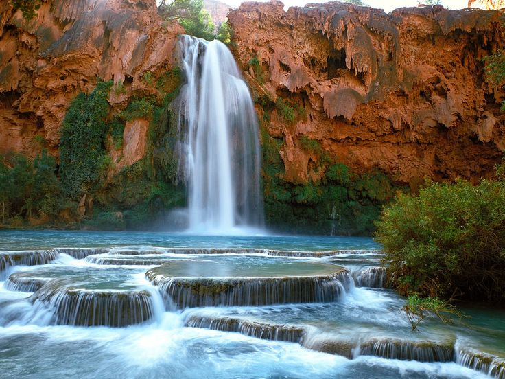 Havasu Falls, Havasupai Indian Nation in a side canyon to the Grand Canyon in Arizona. 100 foot mineral water waterfall, water is 68-72 degrees year round. One of several beautiful falls
