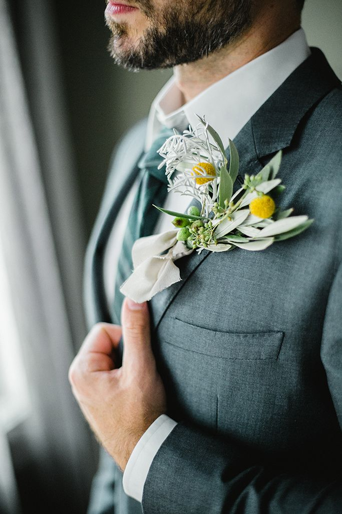 Seyavash decided to skip the classic rose boutonniere and to add a punch of personality and texture to his classy lapel.