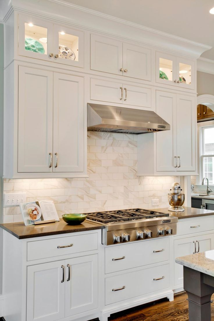 Crisp White Shaker Cabinets And A Marble Subway Tile Backsplash Lend An Elegant Vibe To This
