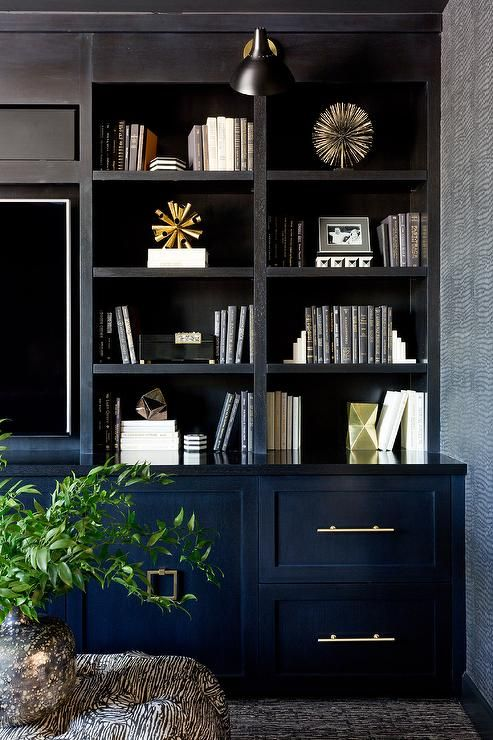 Black Built In Tv Cabinets And Shelves Create A Custom Design In This Alluring Dark Living Room Fin Cabinetry Living Room Built In Tv Cabinet Dark Living Rooms