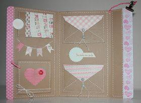 Inspiration: kraft mini album with white and pink from La vida secreta del papel. Lots of detailed photo's.