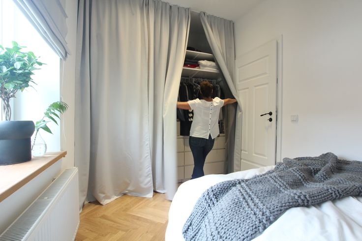 Wardrobe with curtain make bedroom more cozy and give impression of more space. Design by STUDIO10/15 Nadia Mitłosz