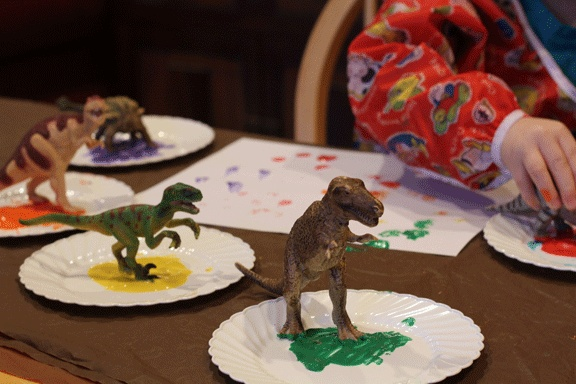 Dinosaur Footprint Painting:  dip dinosaur feet in paint and have kids walk the dinosaurs over paper.