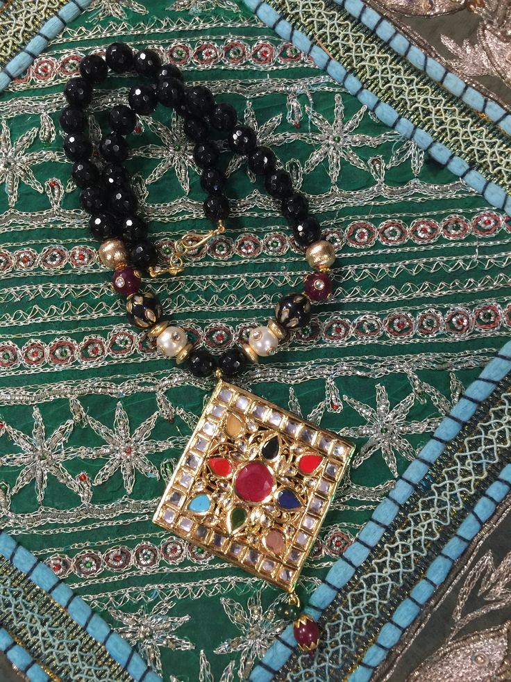 Natural tourmaline shows many diverse personalities with a gamut of beautiful colors. Mixed with a traditional Indian pendant of navaratna or the nine stones that energize your planets the necklace is very lucky to wear or gift as well. Earthy artisan handcrafted jewelry by Mogul.