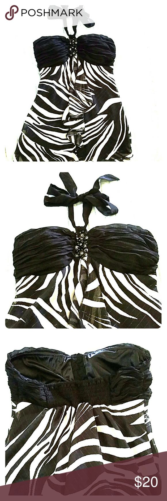 Zebra halter top Ready for summer? This top can either be dressed up where with a black pencil skirt or jeans and heels. marine blu Tops
