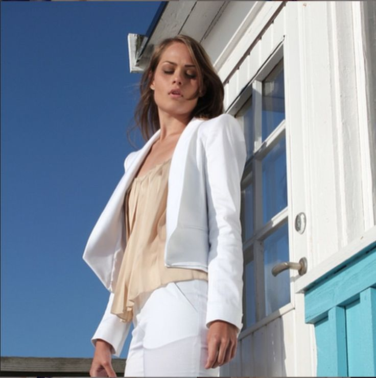 A white suit is the outfit you don't think you need until you have one and then can't live without it! A true summer garment which can aslo be used separately; just style the blazer with some washed out skinny jeans or as we often like to do, use the white pants with a comfy featherlight cashmere sweater. In any case dress it up, dress it down, dress it how ever you want to. Be city chic or casual marina cool. Countless ways to style it and countless reason to love it