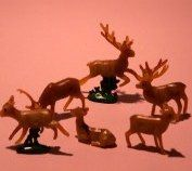 "1/2"" to 1 1/4"" tall set of plastic reindeer."