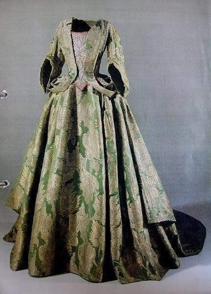 This dress is known as the Valdemar Slot Gown. The fabric is moss green silk brocade with real gold threads, dating from 1695-1700 milestosew