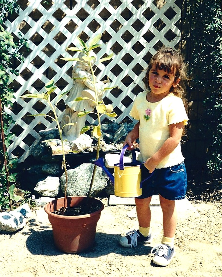 OUR GRANDDAUGHTER SAMANTHA WOODWARD WATERING FOWERS...WOODWARD FARM