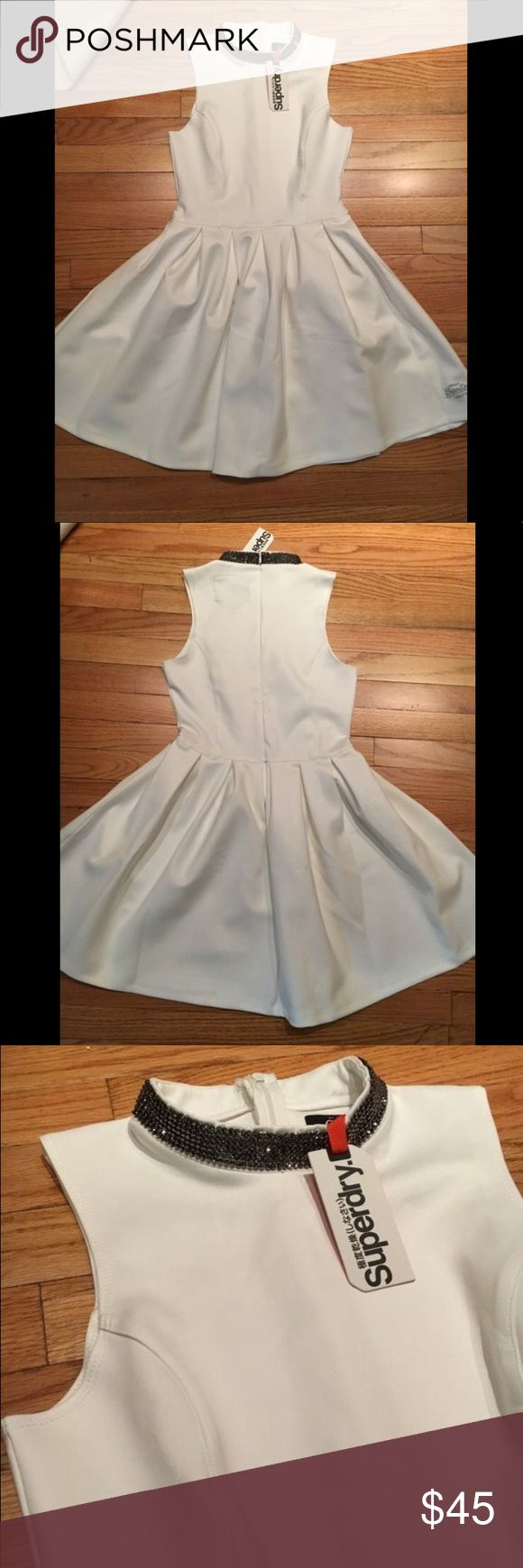 Super Dry White Tennis Dress Super dry white tennis dress with beaded collar perfect for work or that summer rooftop party Superdry Dresses