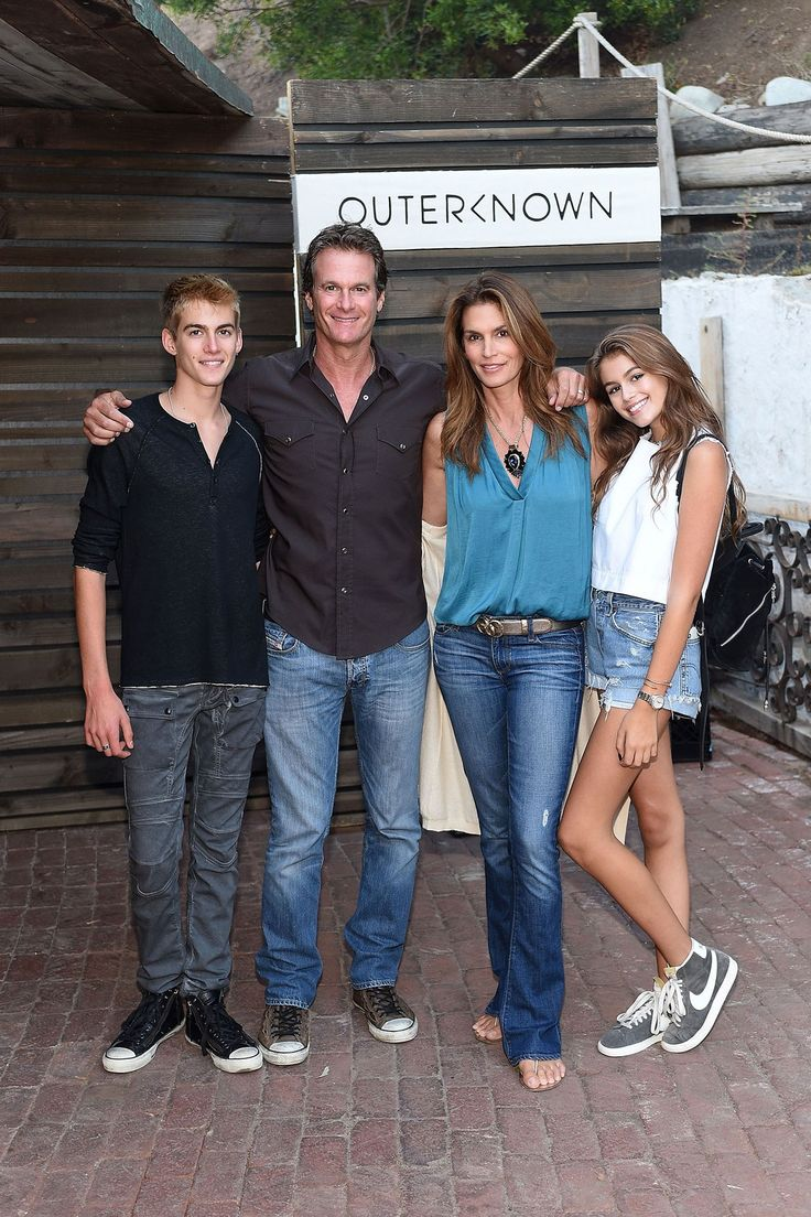 August 29 Cindy Crawford poses with her husband, Rande Gerber, and their two children, Presley and Kaia at Kelly Slater's fashion brand launch in Malibu.