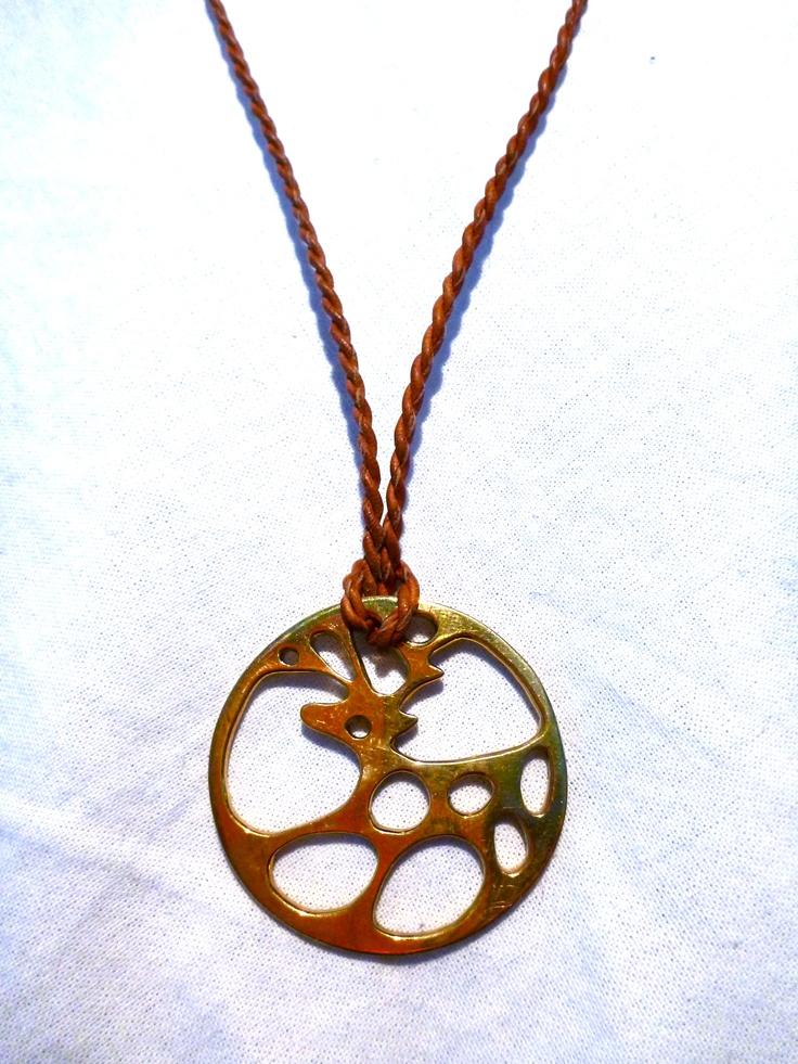 tradtitional sami handcraft. Materials: brass, reindeer leather