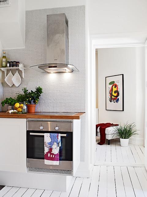 White kitchen. Love the wood floor!