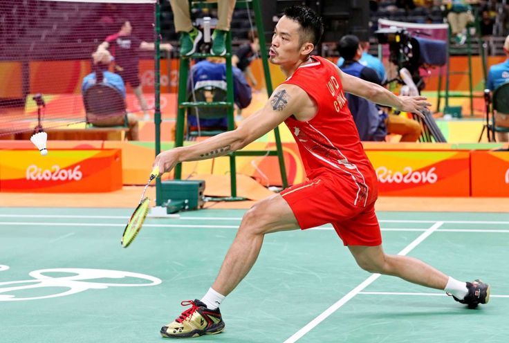 Dan Lin of China strteches for a shot during badminton preliminaries in the Rio 2016 Summer Olympic Games at Riocentro - Pavilion 4.     -  Best images from Aug. 11 at the Rio Olympics