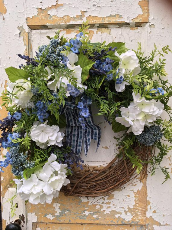 Summer Wreath for Front Door, Spring Wreath, Front Door Wreath, Spring Decor, Hydrangea Wreath  This bright and cheerful wreath can greet your guests for Easter, Spring and Summer. It is overflowing with large white hydrangeas, lovely blue silk flowers, blue accents, ferns and a festive blue and white bow.  The finished size from tip to tip is 21 x 20 x 9.  Thank you for visiting my shop!   To view all the items in my shop, please click on this link: https://www.etsy.com/shop&#...