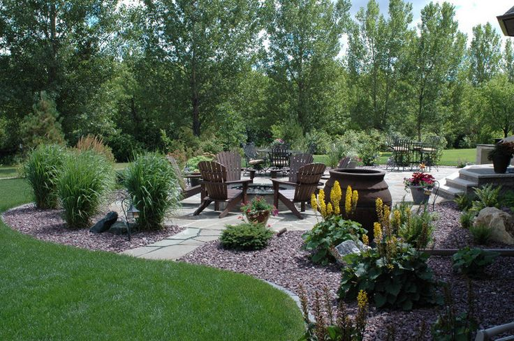 Backyard fire pit area landscaping pinterest for Landscapers in my area