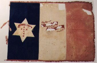 4th Alabama Infantry (Co. E, Conecuh Guards). This flag was presented to the Conecuh Guards at the Sparta Depot in Conecuh County on April 24, 1861. It was one of ten company flags used during a dress parade at Harpers Ferry, Virginia in June 1861 and was reported to be illustrated in an issue of Harper's Weekly. When the 4th Alabama was brigaded under General Bernard Bee all of the company flags were turned in except for that of the Marion Light Infantry.