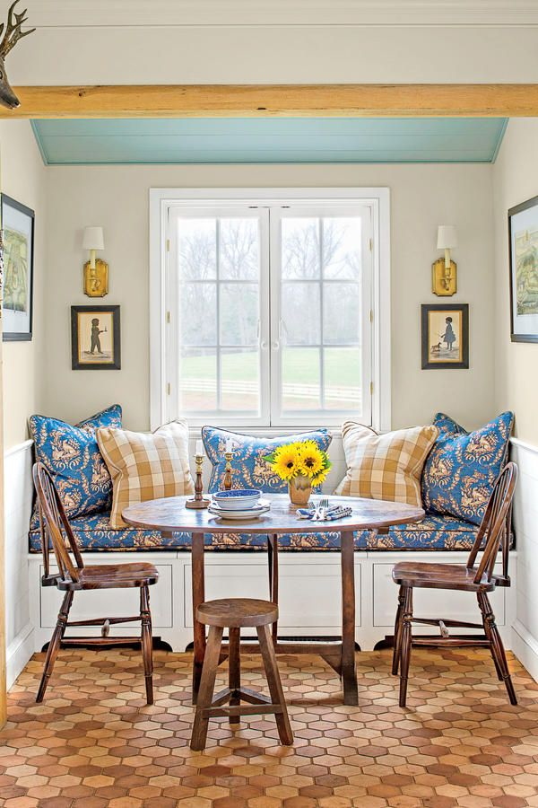 """The Dining Nook - The Art of Living Small - Southernliving. """"Symmetry is so important. It imposes order and soothes the eye,"""" says Blount. """"Sometimes asymmetry is nice and necessary, but in a small space where you see everything in one look, the best image is one that doesn't make your eye work so hard."""""""